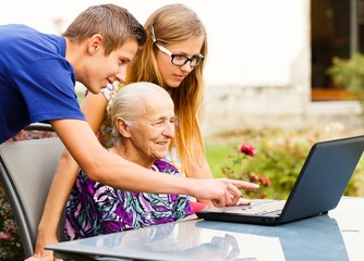 Grandson Helping Grandmother with Modern Technology