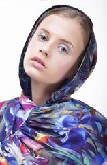 Urban Fashion. Portrait of Teenager Girl in Blue Hood