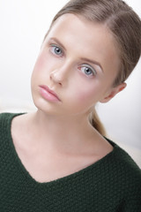 Portrait of Adorable Comely Teen Girl in Green