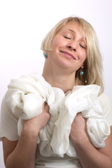 Closed eyes young woman with white cloth