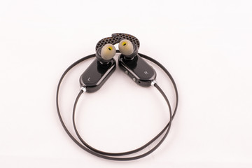 Wireless earbuds on white background