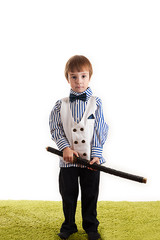 little boy standing with a sword
