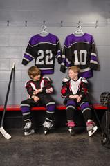 Hockey Player Boys Getting Dressed