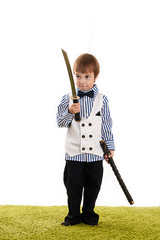 little boy standing with a sword in hand