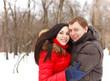 Happy couple having fun in the winter park