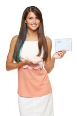 Smiling woman holding envelope