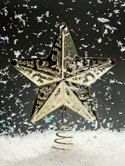 Christmas star with falling snow