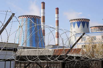 Russia, thermal power station over a barbed wire fence