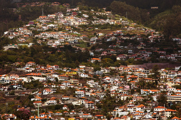 Many houses are located on a high mountain