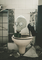 Gas mask on a toilet