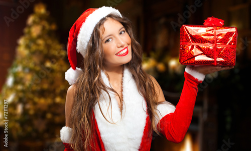 canvas print picture Beautiful woman wearing Santa Claus costume