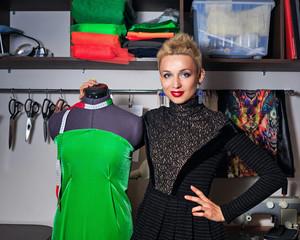 Fashion designer working with dummy