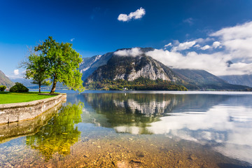 Crystal clear mountain lake in full sunlight