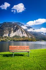 Wooden bench near a mountain lake