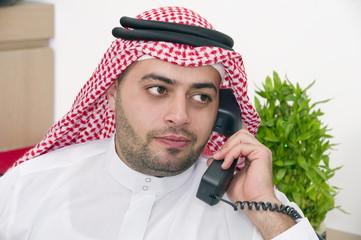 Arabian Businessman talking on phone