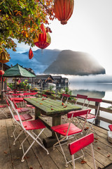 Chinese restaurant on the foggy lake in the Alps