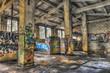 Empty derelict warehouse with concrete pillars