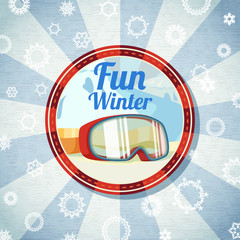 Badge with snowboarders or skiers goggles, -Fun Winter- slogan.