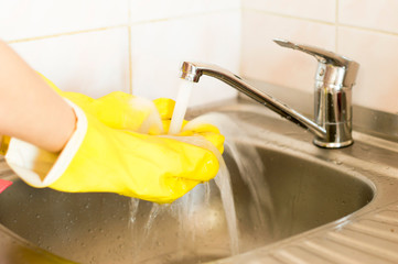 The process of washing hands in yellow gloves