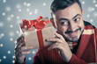 Male holding a red ribbon gift box