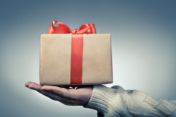 Great red ribbon gift box on a hand. Gift boxes concept for gif