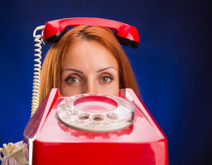 Redhead women with red telephone