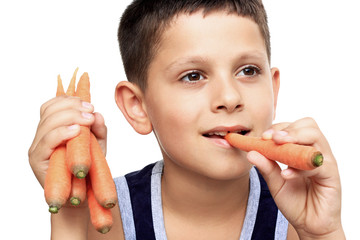 Boy eating carrot isolated on white background