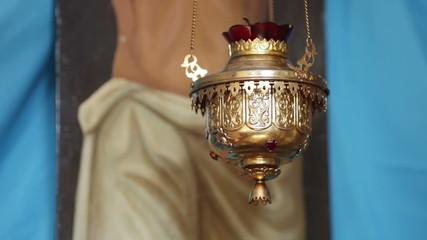 Lampadas before an icon fragment