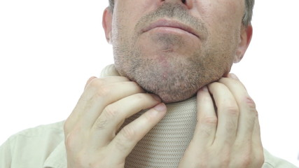Man in Neck Support Brace Scratching