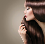 Beautiful woman with long smooth shiny straight hair. Hairstyle