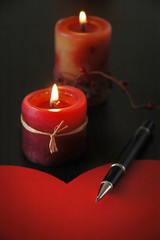 Detail of love letter with pen and candles