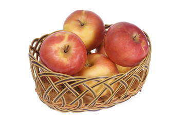 Apples in a basket isolated