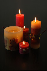 composition of lighting candles on a dark background