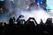 People taking photographs with touch smart phone during a music - 72119825
