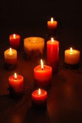 Group of candles on a dark background
