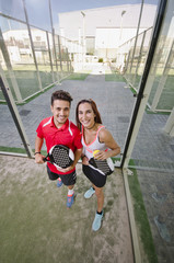 Paddle tennis woman and man team posing