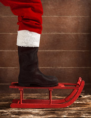 Red sled with the boot of Santa Claus