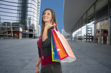 young woman smiling while doing shopping in a city center