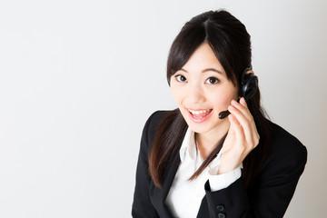 asian businesswoman using headset