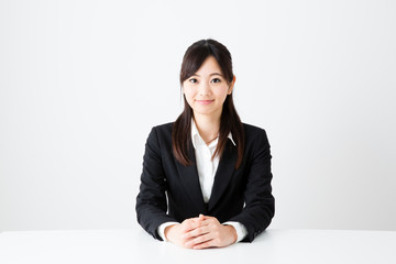 asian businesswoman sitting on the table