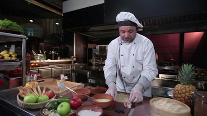 Smiling cook making tasty dessert pancakes, serving breakfast