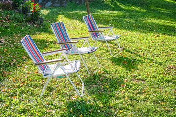 Three empty chairs in backyard