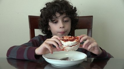 Healthy boy eating rice cakes with jam