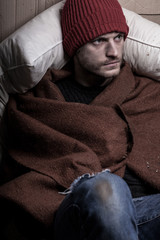 Homeless man covers himself with a blanket