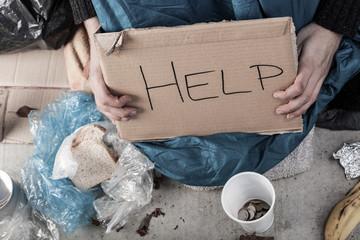 A homeless man asking for money