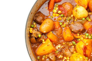 a hearty beef stew simmering in a large red pot