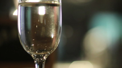Glass filled with sparkling champagne on a restaurant table