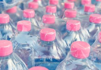 screw cap of  water bottles in plastic wrap