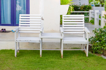 white chair set  on grass floor