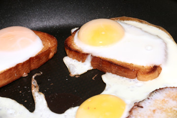 toasted bread and fried eggs as part of a morning meal